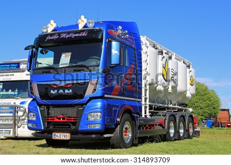 ALAHARMA, FINLAND - AUGUST 7, 2015: New MAN TGX 35.480 8X4 year 2015 for animal feed or bulk transport on display in Power Truck Show 2015. - stock photo