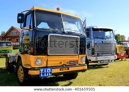 ALAHARMA, FINLAND - AUGUST 7, 2015: Volvo F88 year 1968 and Scania 141 classic trucks on display on Power Truck Show 2015.
