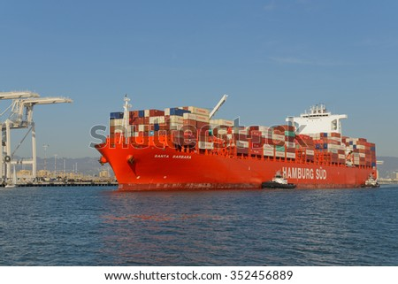 "Alameda, CA - March 9, 2015: Oakland Oakland Container Shipyard, San Francisco Bay, the Hamburg Sud ship ""Santa Barbara"" entering harbor, maneuvering into dock"