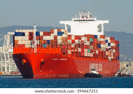 "Alameda, CA - March 9, 2015: Oakland Oakland Container Shipyard, San Francisco Bay, the Hamburg Sud ship ""Santa Barbara"" maeuvering into dock"