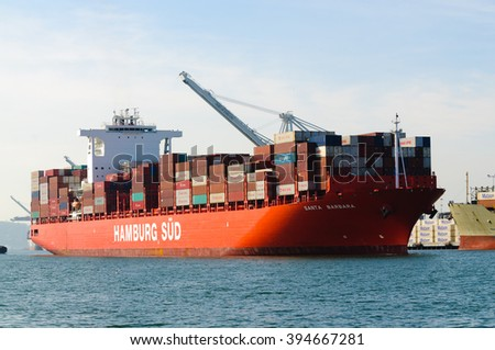 "Alameda, CA - March 9, 2015: Oakland Oakland Container Shipyard, San Francisco Bay, the Hamburg Sud ship ""Santa Barbara"" entering harbor, maeuvering into dock - stock photo"