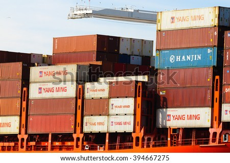 Alameda, CA - March 9, 2015: Oakland Oakland Container Shipyard, San Francisco Bay, various Chinese containers on a ship - stock photo