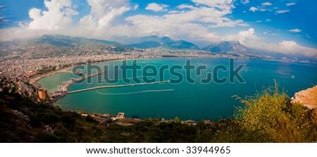 Alanya city harbor panorama in the evening - stock photo