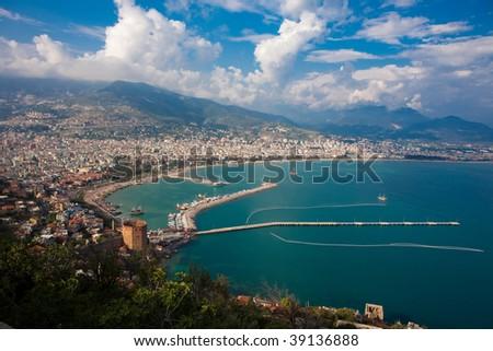 Alanya city (Turkey) harbor in the evening - stock photo