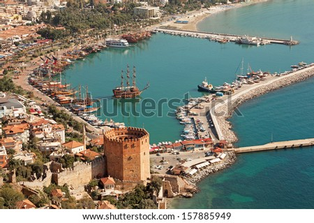 Alanya harbor and Kizil Kule tower. Turkey. Canon 5D Mk II. - stock photo