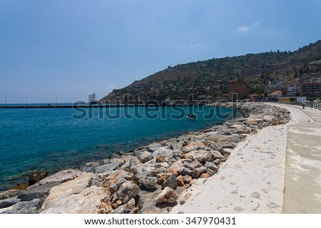 ALANYA, TURKEY - JULY 09, 2015: The coastline near the sea port of Alanya. Alanya - a popular holiday destination for European tourists.