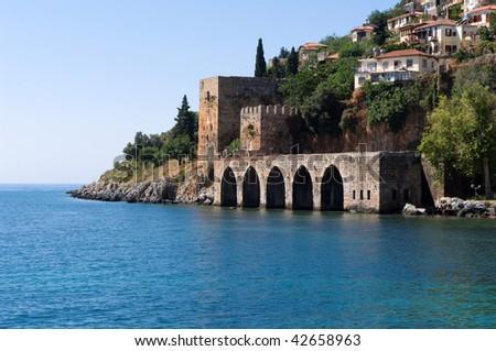 Alanyas' mediterranean coastline and Ottoman castle (Turkey) - stock photo