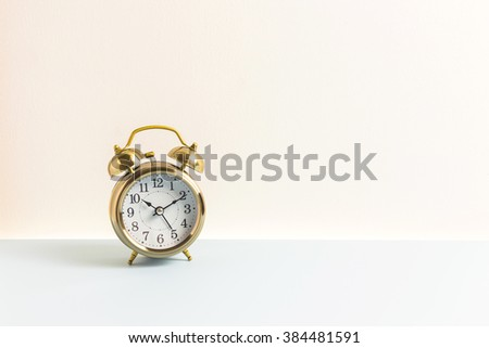Alarm circle clock with white wall