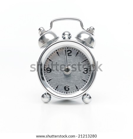 alarm clock against white background - stock photo