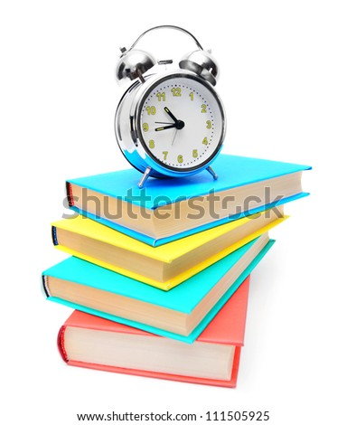 alarm clock and books . - stock photo
