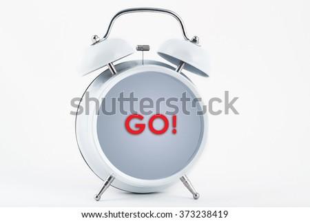 Alarm clock and go - stock photo