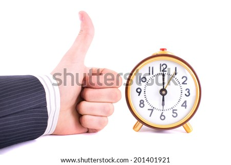 Alarm clock and hand isolated on white - stock photo
