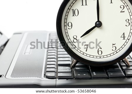 alarm clock and laptop on white background - stock photo