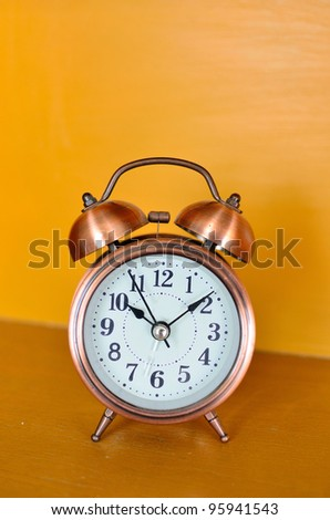 alarm clock and orange background