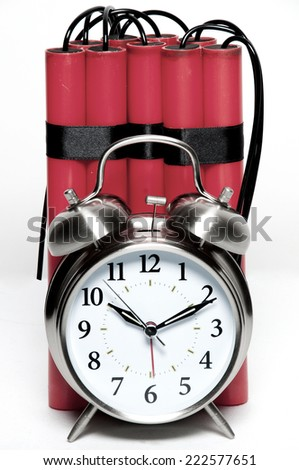 alarm clock and sticks of dynamite fashioned into a time bomb - stock photo