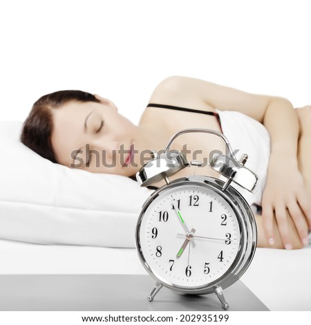 Alarm clock being placed on a nightstand - stock photo