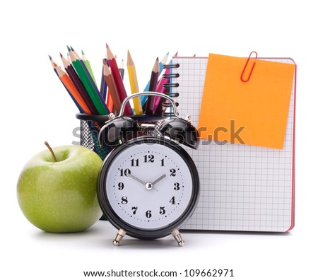 Alarm clock, blank notebook sheet and apple. Schoolchild and student studies accessories. Back to school concept. - stock photo