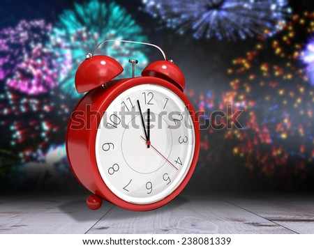 Alarm clock counting down to twelve against bleached wooden planks background - stock photo