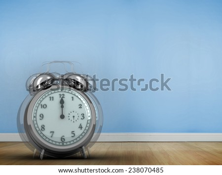 Alarm clock counting down to twelve against blue room with wooden floor - stock photo