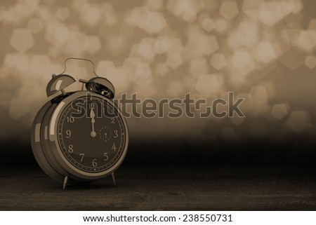 Alarm clock counting down to twelve against shimmering light design over boards - stock photo