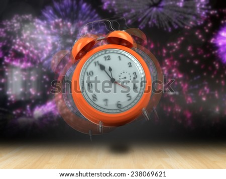 Alarm clock counting down to twelve against wooden planks - stock photo