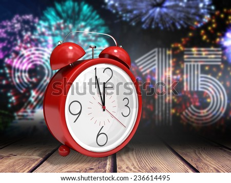 Alarm clock counting down to twelve against wooden planks background - stock photo