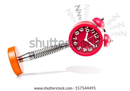 Alarm Clock in the act of Sleeping - stock photo