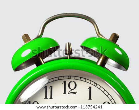 Alarm clock in the foreground - stock photo