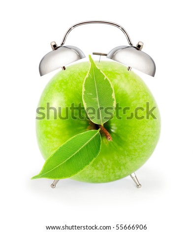 alarm clock in the form of an apple (collage made up of several files) - stock photo