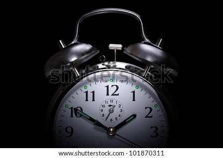 Alarm clock in the middle of the night  isolated on black concept for insomnia - stock photo