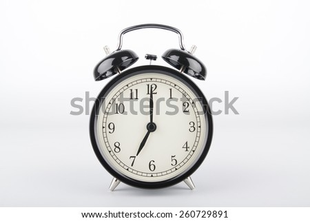 Alarm clock is showing the right time. Seven o'clock. - stock photo