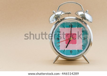 Alarm clock is showing time for 7 AM - stock photo