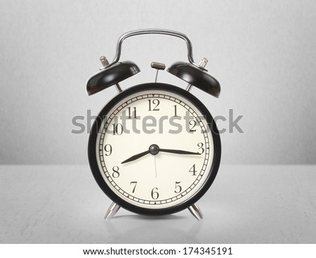 alarm clock isolated on gray background