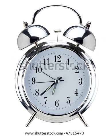 Alarm clock. Old-fashioned style silver alarm clock, isolated against a white background. - stock photo
