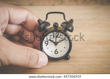 alarm clock on a table. Photo in retro color image style