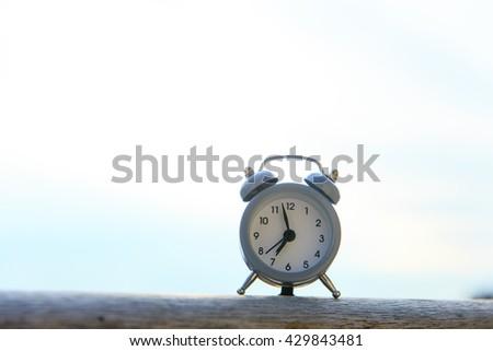 Alarm clock on balcony - stock photo