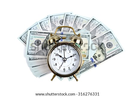 Alarm clock on money background - stock photo