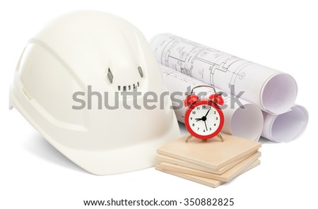 Alarm clock on paving tiles with white helmet on isolated white background