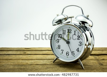 alarm clock on table