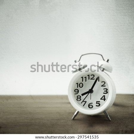 alarm clock on the table in vintage color style