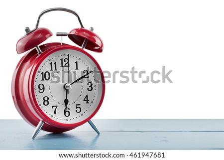 alarm clock on the table isolated on white background.