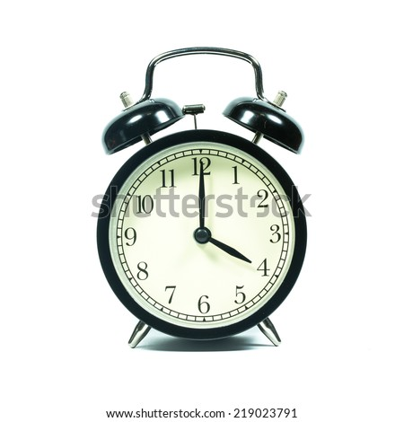 Alarm clock on white background. At 4 .