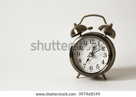 alarm clock on white backgrounds / time concept with watch or clock / Vintage alarm clock / Metal Alarm clock on isolate white background