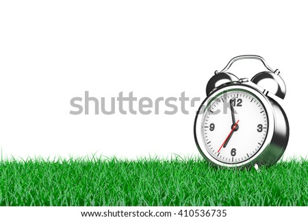 Alarm Clock over Grass on a white background. 3d Rendering - stock photo