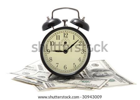 alarm clock over heap of money isolated - stock photo