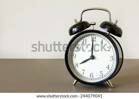 alarm clock ring wake up 8 am in the mornig - stock photo