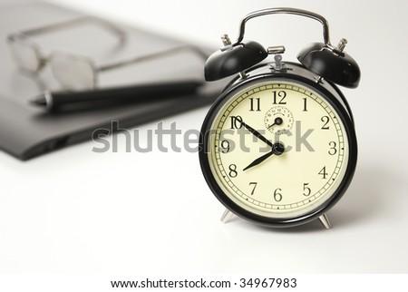 Alarm clock set to ten to eight,Time Concept - stock photo