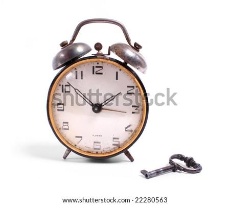 alarm-clock with a key - stock photo