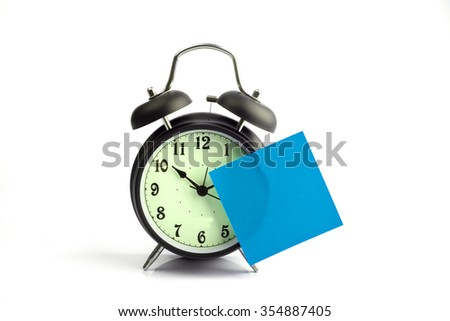 Alarm clock with blue sticky paper - stock photo