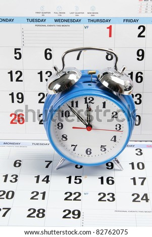 Alarm Clock with Calendar Pages - stock photo